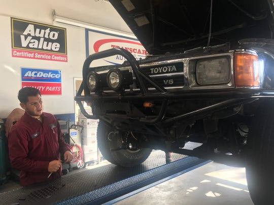 Bergin's Automotive Service Manager Cruz Pulido checks out a vehicle at the business in Camarillo. Pulido recommends that holiday travelers check tire pressure,hoses, belts, transmission fluid and engine oil levels,windshield wipers,brakes,turn signals, headlights and horn.
