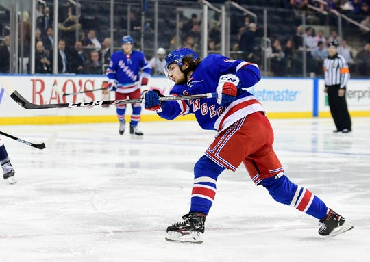 Artemi Panarin #10 of the New York Rangers fires a shot for a goal in the second period of their game against the Washington Capitals at Madison Square Garden on Nov. 20, 2019 in New York City.