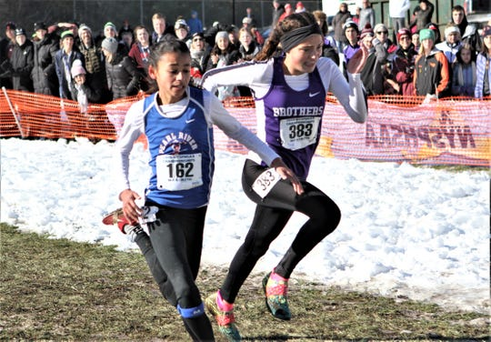 Pearl River 8th-grader Mady Moroney (l) edges CBA-Syracuse's Oliva Morganti (r) for second place in the girls Class B race at the 2019 State Cross-Country Championships.