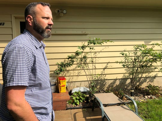 "Dr. Jim Richter, a survivor of sexual abuse by a priest who is a member of the review board in the Archdiocese of St. Paul and Minneapolis, walks outside his home in Minneapolis, on Sept. 21, 2019. Richter praises the work of the review board he serves on, but says others are full of ""unqualified, well-meaning, but ultimately incompetent"" members."