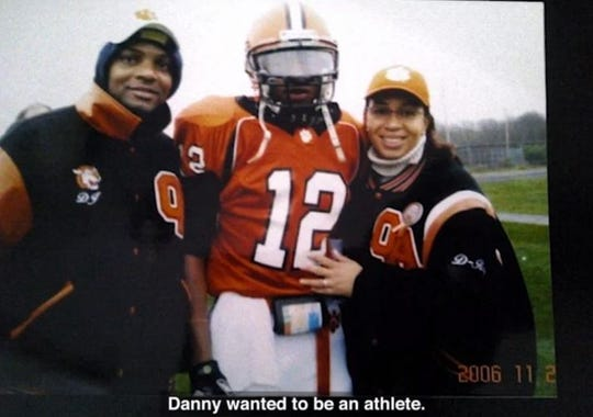 "Danroy Henry Sr., left, and Angella Henry are seen with their son, Danroy ""DJ"" Henry, in a 2006 photo, shown during a public service announcement video released by ""The Responsibility Program,"" through the Players Coalition, a nonprofit founded by NFL players."