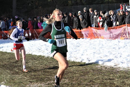 Brewster's Elsa Neubauer, with no right shoe, heads to finish at the Nov. 16, 2019 State Cross-Country Championships, followed by Pearl River's  Niamh Durcan. Both runners will compete in Saturday's State Federation Cross-Country Championships at Bowdoin Park in Wappingers.