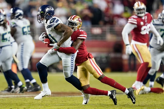 Seattle Seahawks wide receiver Josh Gordon, left, runs against San Francisco 49ers defensive back Emmanuel Moseley on Monday, Nov. 11.