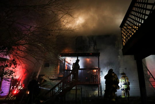 Firefighters work to control a fire that ripped through a home in Richardson Park early Thursday. Firefighters, alerted shortly before 2 a.m., arrived to find flames coming from the home on Atlantic Avenue near Elsmere.