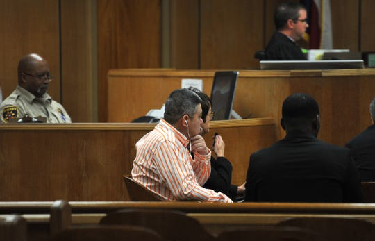 Juan Alberto Manrique, center, listened as a woman testified in his jury trial Thursday morning that is being held in the 30th district courtroom. Manrique has been charged with multiple sex crimes.