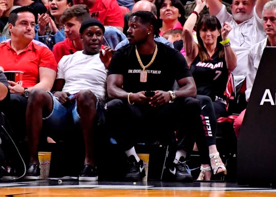 Antonio Brown is seen sitting courtside at a Grizzlies-Heat game in Miami.