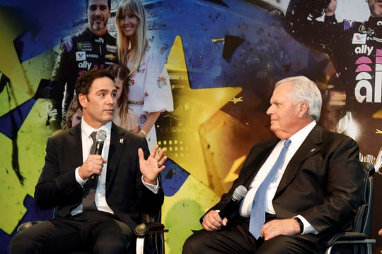 Jimmie Johnson, left, and team owner Rick Hendrick speak at retirement announcement for Johnson on Thursday at Hendrick Motorsports headquarters.