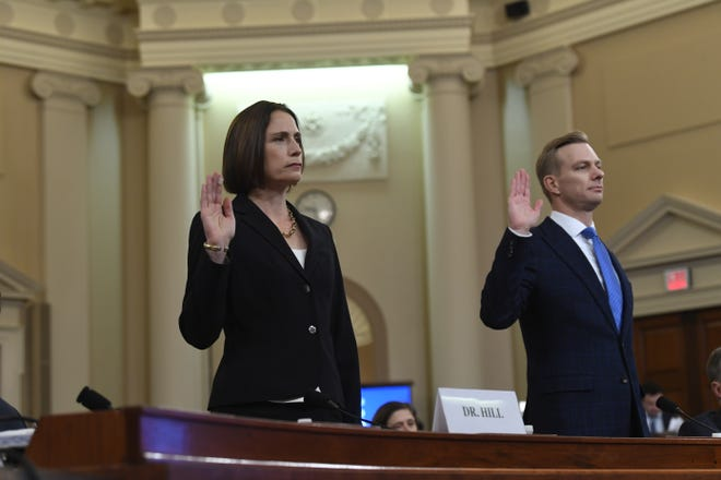 National Security Council official Fiona Hill and State department official David Holmes are sworn in before they testify before the Permanent Select Committee on Intelligence on Nov. 21, 2019.
