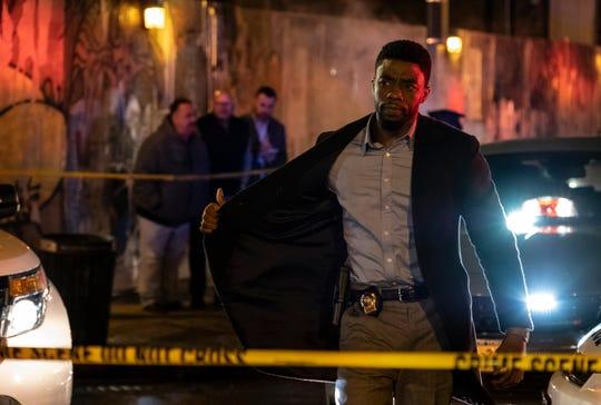 "Chadwick Boseman stars as a crusading cop in ""21 Bridges."""