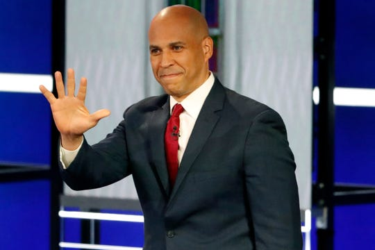 Democratic presidential candidate Sen. Cory Booker, D-N.J., walks on the stage before a Democratic presidential primary debate in Atlanta.