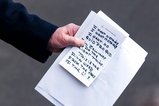 A close-up view of President Donald Trump's notes as he speaks to the media about the impeachment proceedings. (Photo: JIM LO SCALZO, EPA-EFE)