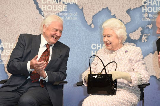 Queen Elizabeth presented Sir David Attenborough with the 2019 Chatham House Prize on Wednesday, shortly after Buckingham Palace announced Prince Andrew would step back from royal duties.