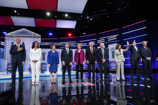 ATLANTA, GEORGIA - NOVEMBER 20: Democratic presidential candidates (L-R) Sen. Cory Booker (D-NJ), Rep. Tulsi Gabbard (D-HI), Sen. Amy Klobuchar (D-MN), South Bend, Indiana Mayor Pete Buttigieg, Sen. Elizabeth Warren (D-MA), former Vice President Joe Biden, Sen. Bernie Sanders (I-VT), Sen. Kamala Harris (D-CA), former tech executive Andrew Yang, and billionaire Tom Steyer arrive on stage before the start of the Democratic Presidential Debate at Tyler Perry Studios November 20, 2019 in Atlanta, Georgia. Ten Democratic presidential hopefuls qualified from the larger field of candidates to participate in the debate hosted by MSNBC and The Washington Post.  (Photo by Joe Raedle/Getty Images) *** BESTPIX *** ORG XMIT: 775440736 ORIG FILE ID: 1189023664