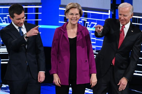 Democratic presidential hopefuls Pete Buttigieg, mayor of South Bend, Sen. Elizabeth Warren, D-Mass., and former Vice President Joe Biden, arrive onstage for the fifth Democratic presidential primary debate in Atlanta.