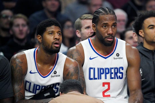 Paul George and Kawhi Leonard on the Clippers' bench in the second half.