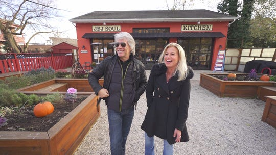 Jon Bon Jovi with CBS' Tracy Smith outside the JBJ Soul Kitchen community restaurant in Red Bank.