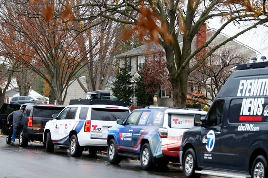 Media vehicles line Kings Mountain Road in Freehold Township outside John Ozbilgen's family home Friday, November 22, 2019.  The ex-boyfriend of missing Stephanie Parze was found dead earlier in the day.