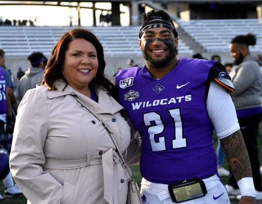 Tracy James with his mother, Angela Bradley, after the Abilene Christian football game against Southeastern Louisiana on Nov. 16.