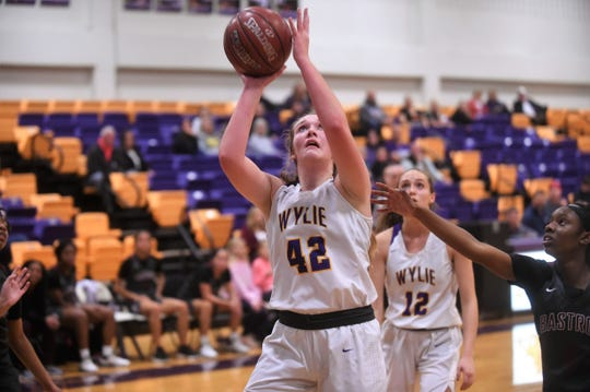 Wylie's Bailey Roberts (42) takes a shot against Bastrop in the first round of the Polk-Key City Classic at Bulldog Gym on Thursday, Nov. 21, 2019. Roberts and Karis Christian are the two Lady Bulldogs returning starters and were recently named team captains.