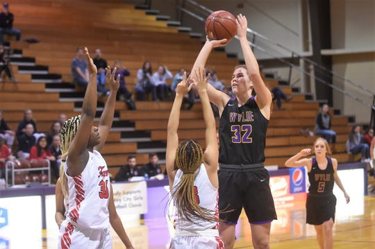 Wylie's Kenyah Maroney (32) takes a shot over a pair of Stevens defenders in the Polk-Key City Classic championship bracket quarterfinal at Mabee Complex on Friday. The Lady Bulldogs won 36-34 to advance to the semifinals.