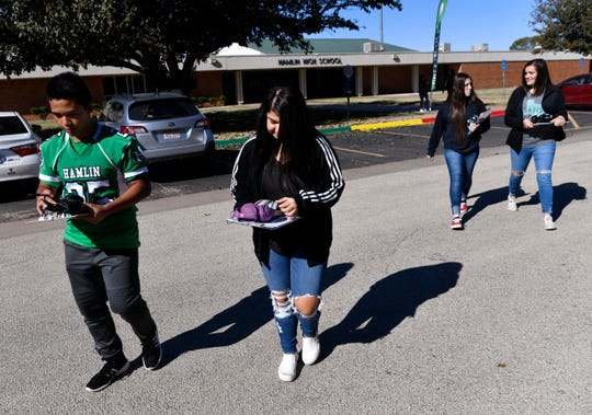 Hamlin High School students cross the street to HomePlace Manor nursing home Oct. 31.