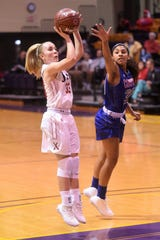 Cooper's Brooke Galvin (33) shoots around Cooper's Keiana Kemp (30) during the Polk-Key City Classic championship quarterfinal at HSU's Mabee Complex on Friday. The Lady Indians won 40-31.
