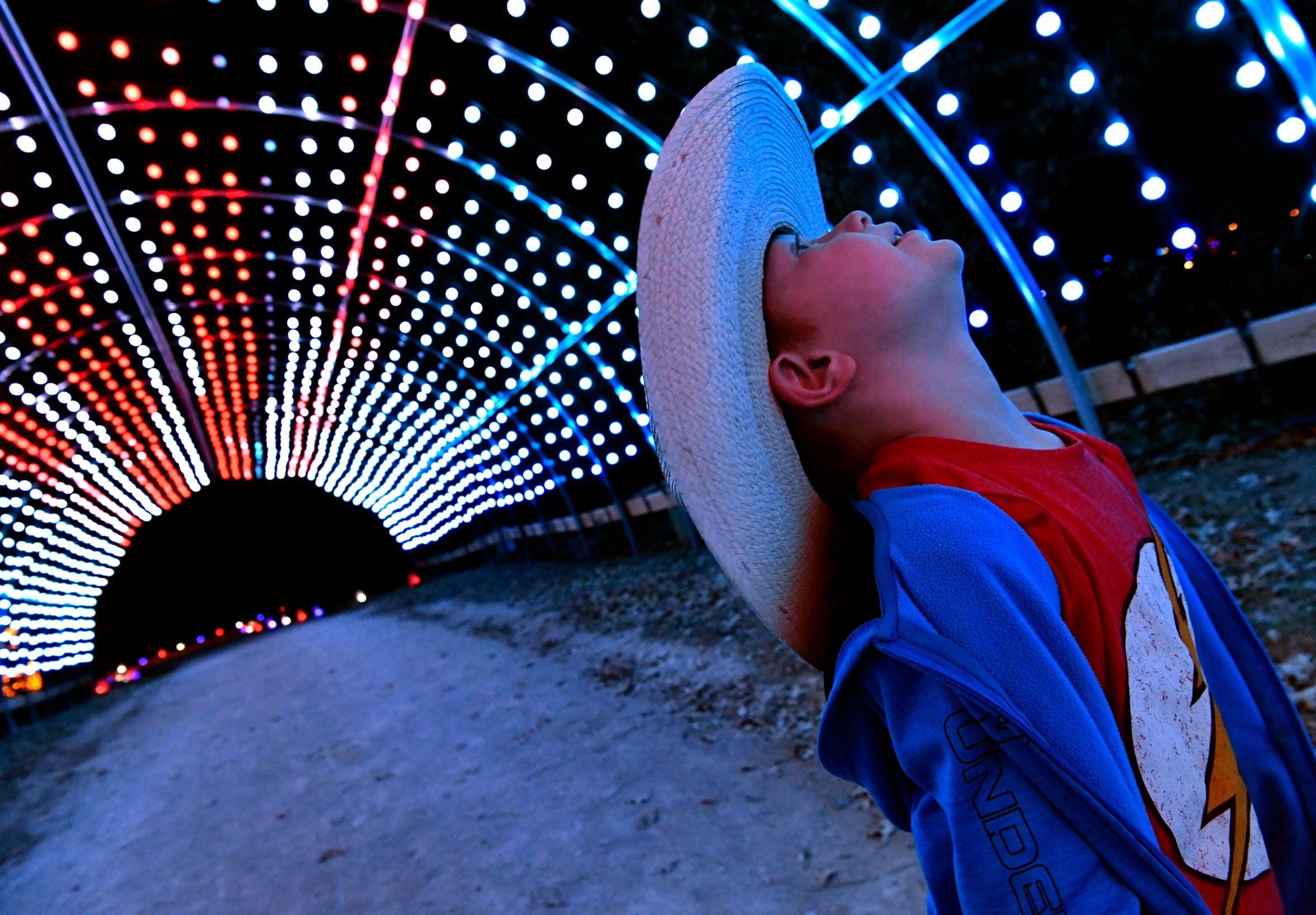 Bowen Cook, 6, takes in the swirling lights of a tunnel during a preview of Winter Lightfest.