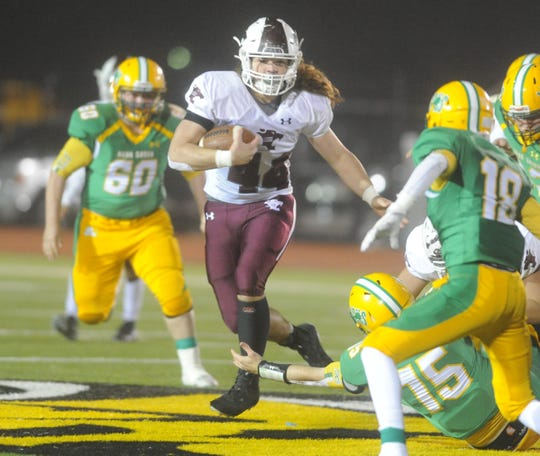 Hawley running back Colton Marshall (44) carries the ball against New Deal in a Class 2A Division I area playoff Thursday, Nov. 21, 2019, at Tiger Stadium in Snyder.