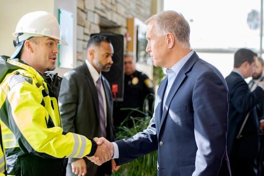 U.S. Sen. Thom Tillis shakes hands with Asheville Regional Airport employees following the announcement and presentation of grant money to the Asheville Regional Airport, as well as other airports across the nation, at the airport on Nov. 22, 2019. The Asheville Regional Airport will receive more than $10 million.
