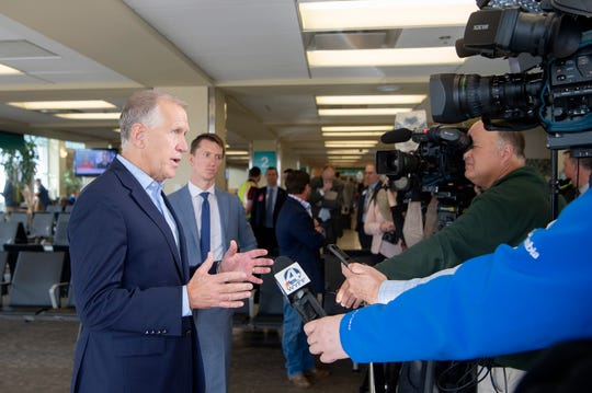 U.S. Sen. Thom Tillis talks with members of the media after  the announcement and presentation of grant money to the Asheville Regional Airport, as well as other airports across the nation, at the airport on Nov. 22, 2019. The Asheville Regional Airport will receive more than $10 million.