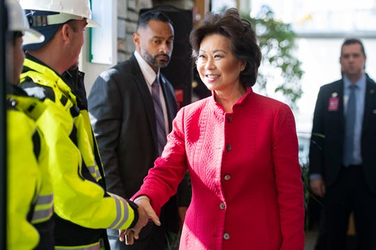 U.S. Secretary of Transportation Elaine L. Chao, tshakes hands with airport employees after the announcement and presentation of grant money to the Asheville Regional Airport, as well as other airports across the nation, at the airport on Nov. 22, 2019. The Asheville Regional Airport will receive more than $10 million.