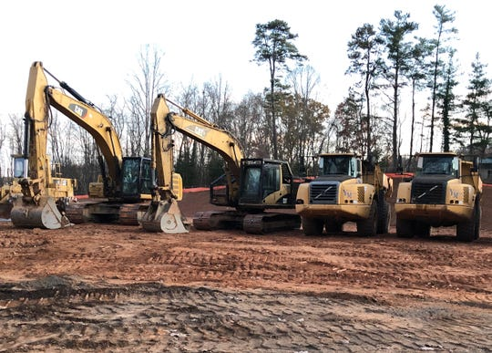 Workers have been using heavy duty earth moving equipment to prepare the site for The Retreat at Arden Farms, a 312-unit apartment complex being built on a former horse farm off Long Shoals Road in Arden. The first units should be finished by August 2020.
