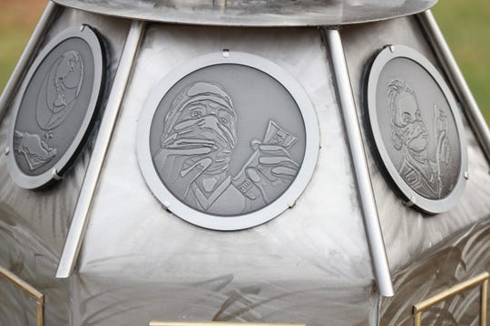 Medallions set into the sundial's base represent the individuals who manufacture and create Printpak products.
