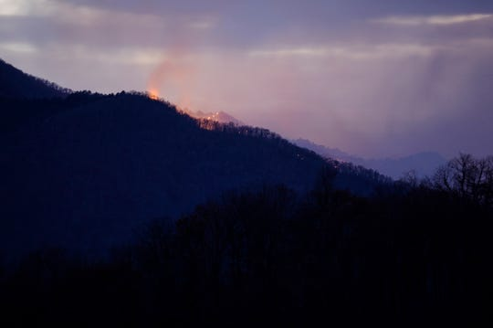 Visitors driving the Blue Ridge Parkway about 30 miles southwest of Asheville can expect to smell smoke and see flames shooting from the summit of Cold Mountain.
