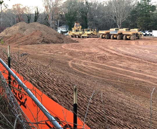 Grading work for the Retreat at Arden Farms, a 312-unit apartment complex, is underway off Long Shoals Road.