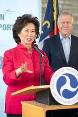 U.S. Secretary of Transportation Elaine L. Chao, talks with members of the media during the announcement and presentation of grant money to the Asheville Regional Airport, as well as other airports across the nation, at the airport on Nov. 22, 2019. The Asheville Regional Airport will receive more than $10 million.