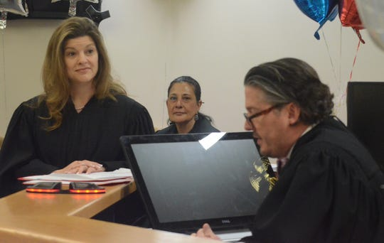 Circuit Judge Tina Yost Johnson, from left, Tribal Chief Judge Melissa Pope and Court of Appeals Judge Brock Swartzle, presided at Calhoun County Adoption Day on Friday.