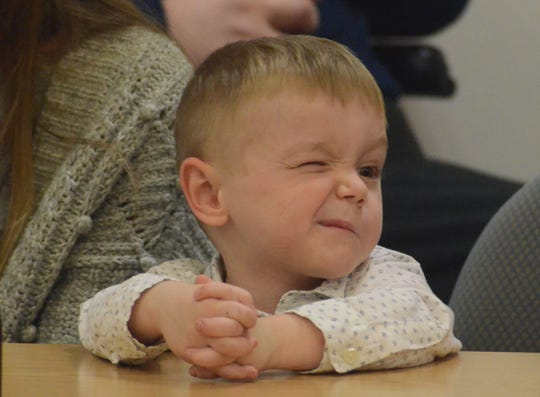 Elijah Schmidt was having fun making faces as the speeches continued during Adoption Day.