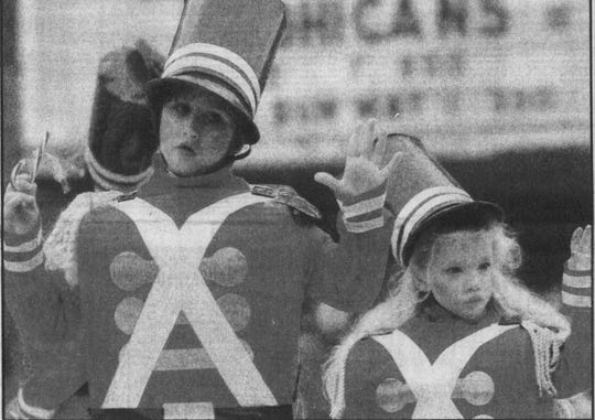 Bethany Oliver, left, and Linda Bunzey, both of Endicott, portray soldiers in the 1992 Endicott Holiday Parade.