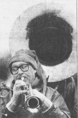 Laurel Fry, of the Maine Community Band, plays in the 1991 Endicott Holiday Parade despite the cold.