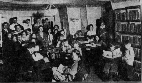 Children attend the branch library at the American House in 1923.