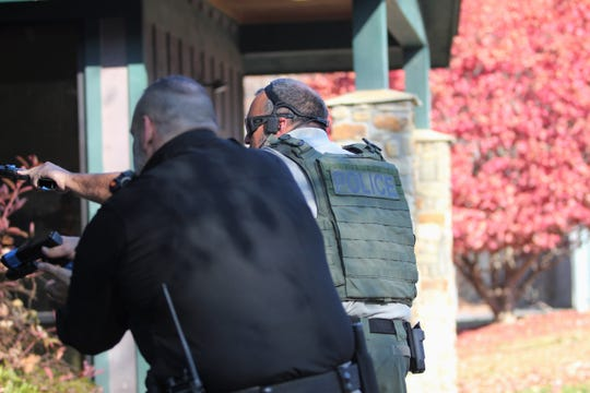 Black Mountain police respond to a training exercise at Town Hall on Nov. 19. The drill was designed to evaluate the town's readiness for emergency situations.