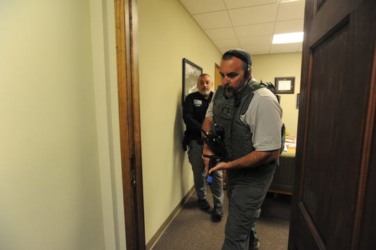 Black Mountain police clear offices in Town Hall during an active shooter simulation on Nov. 19.