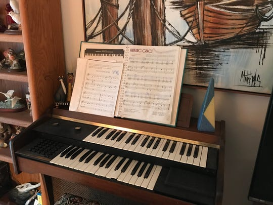 "The sheet music for ""Auld Lang Syne"" and ""Amazing Grace"" remains on the electric organ Sylvia Knight used to play for her husband. ""Amazing Grace,"" she said, was his favorite song."