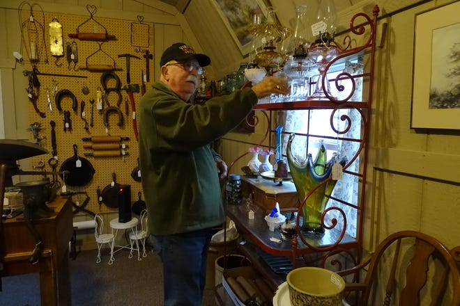 Charles Huston shows off some of the items at C&J Vintage Gifts on Bucyrus Nevada Road, just west of Marion-Melmore Road.