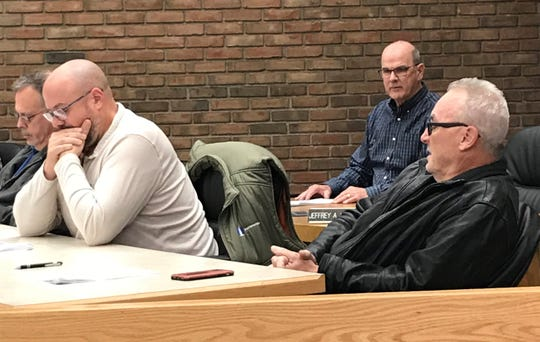 Council members Mark Makeever and Kevin Myers, from left, listen as Mayor Jeff Reser and council member Dan Wirebaugh, right, debate a change to the city's law requiring the service-safety director to live within three miles of the city's center.