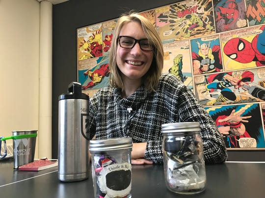 Marina McCoy of Waste Free Earth shows off her almost year's worth of personal trash which fits into just two mason jars.