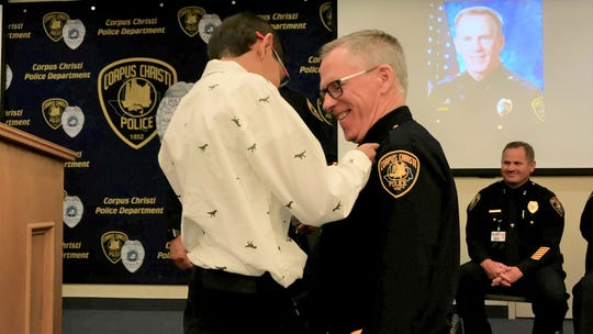 Todd Green's 10-year-old grandson pins a Corpus Christi Police Department assistant chief badge on his uniform on Friday, Nov. 22, 2019. Green was promoted from deputy chief to assistant chief.