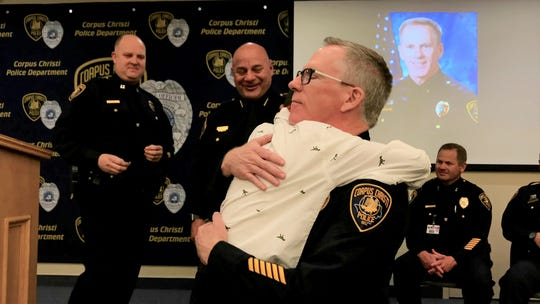 Assistant Chief Todd Green embraces his 10-year-old grandson during his promotion ceremony at Corpus Christi Police Department headquarters on Friday, Nov. 22, 2019.