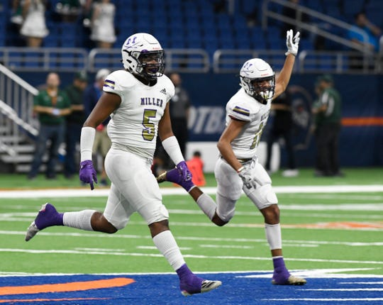 Miller linebacker #5 JayShawn Trimble celebrates during Miller's playoff game against San Antonio Southwest. Miller won 56-6 on Thursday, Nov. 21, 2019 at the Alamodome.